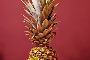 variety of fruits: pineapple, apple,