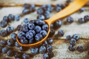 blueberry with wooden spoon