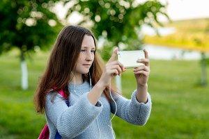 Little girl teenager in summer park