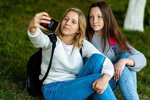 Two schoolgirls teenage girl sitting