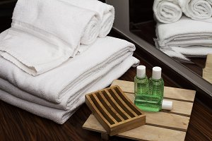 Towels and soap kits in the hotel ba