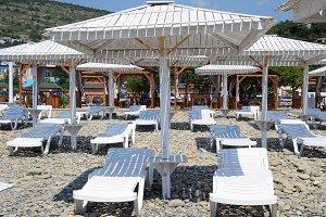 Sun loungers under a canopy