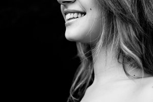 Profile of a beautiful smiling girl