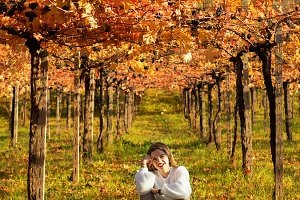 girl sitting in the nature under a g