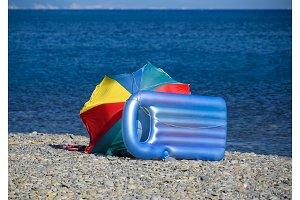 Inflatable mattress and sun umbrella