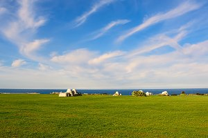 Ancient trulli, countryside, sea and