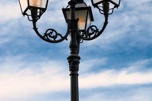 Street lamp lit at dusk