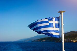 Flag of Greece waving over the see
