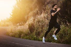 Man running fast on mountain road