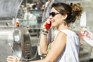 Woman using a telephone booth