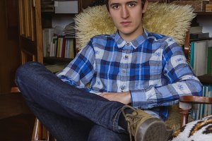 Young man with plaid shirt and jeans