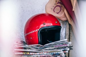 Red Helmet Top of Stacked Newspaper