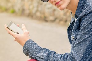Teen with sunglasses and smartphone