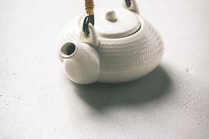 Ctramic teapot on concrete backgroun