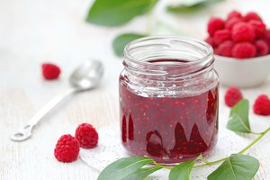 Raspberry jam in a jur and fresh
