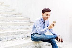 Happy Businessman using Mobile