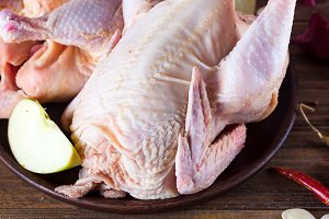 Raw chicken with ingredients for