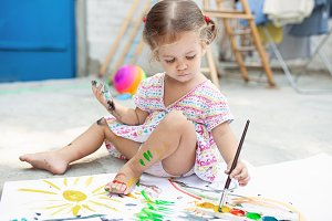 Portrait of little blonde girl paint