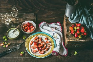 Strawberries crepes on rustic table