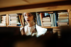 Girl with pigtails in white blouse a