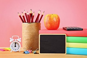 School and office supplies on a pink