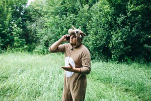 Young man cosplay costume of a cow