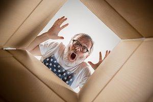 Man unpacking and opening carton box