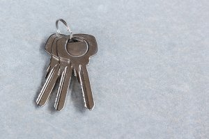 keys lies on cement background.