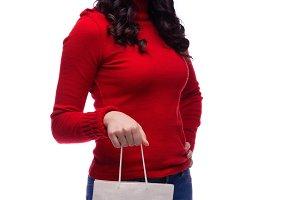 brunette girl with shopping bag