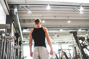 Young man in modern crossfit gym