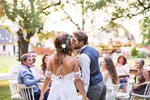 Bride and groom kissing at wedding