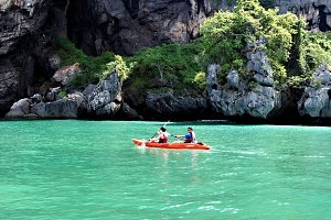 Couple kayaking around island