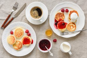 Breakfast table with pancakes coffee