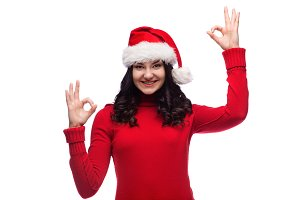 happy young woman wearing santa hat