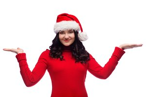 woman in santa hat with open palms