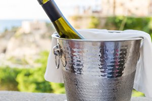 a bottle of wine in an ice bucket