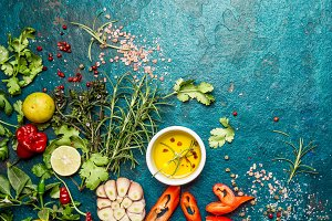 Fresh herbs and spices on blue