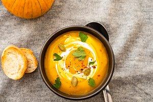 Pumpkin soup with pumpkin seeds on a