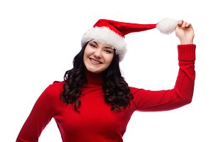 happy woman holding her santa hat