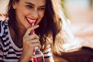 Attractive woman drinking beverage