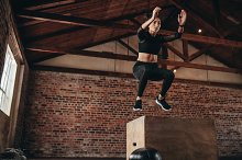 Box jumping workout at gym by  in Sports