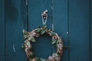 Rustic wreath hanging on door
