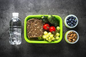 Lunch box with sandwich, vegetables,
