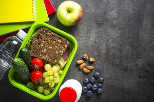 School lunch box and stationery on b