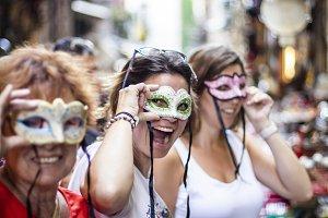 Three women with three masks