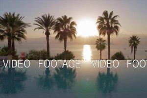 Resort scene with sunset in