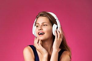 Beautiful woman wearing headphones