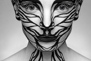 Beautiful girl with creative makeup