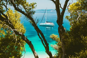 White catamaran yacht in clear blue