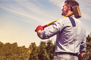 Attractive guy with a sledgehammer